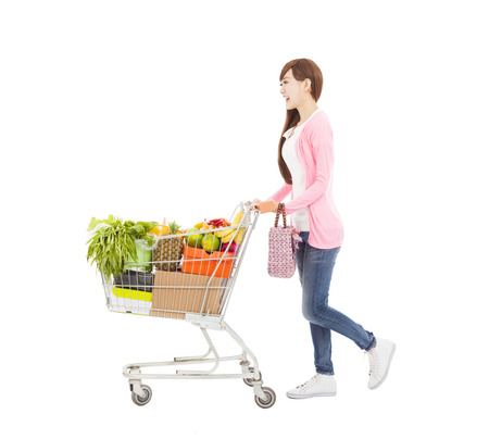 supermarket cart: happy young woman with  shopping cart