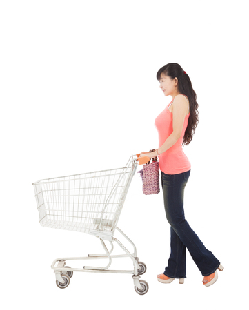 woman shopping cart: young woman with empty shopping cart