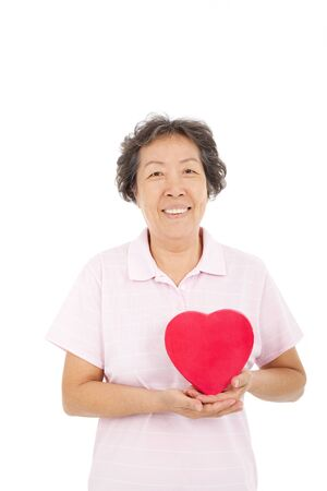 asian elderly: happy asian  senior woman with  red heart Stock Photo