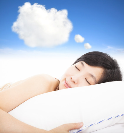 smiling and sleepy woman with dreams cloud sign photo