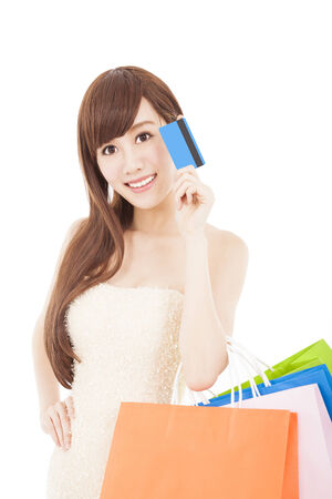 beautiful woman with credit card and shopping bags photo
