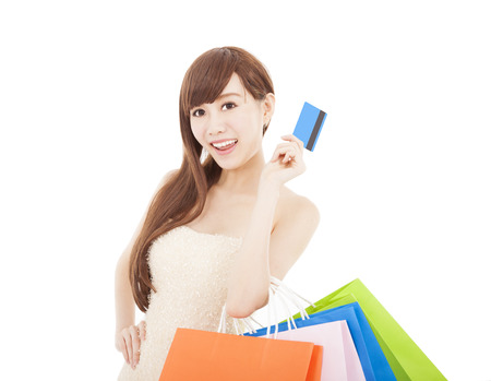 happy woman with credit card and shopping bags photo