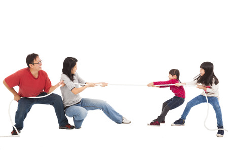 happy family playing tug of war photo