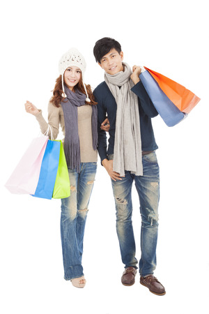 Happy couple doing shopping together photo
