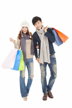 Happy couple doing shopping with winter clothing photo