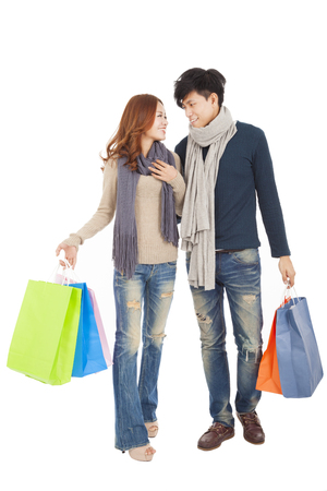 Happy couple doing shopping isolated on white photo