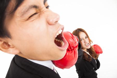 businesswoman hitting businessman isolated on white background photo