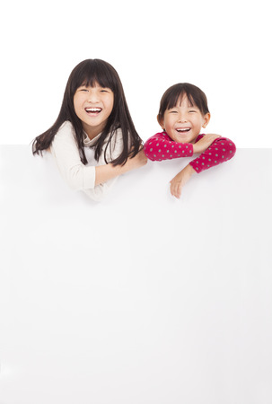 asia children: happy little girls showing blank board on a white background
