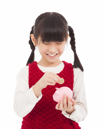 beautiful little girl with piggy bank photo