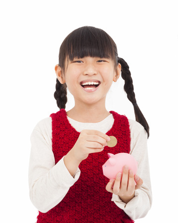 happy little girl save money with piggy bank photo