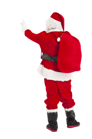 merry Christmas Santa Claus pointing and rear view photo