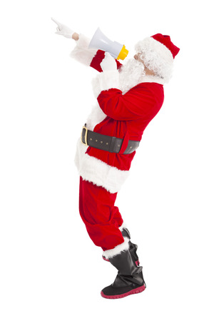 Santa Claus holding megaphone with pointing photo