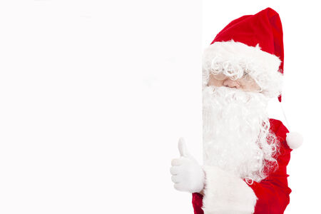 happy Santa Claus pointing at blank banner with thumb up photo