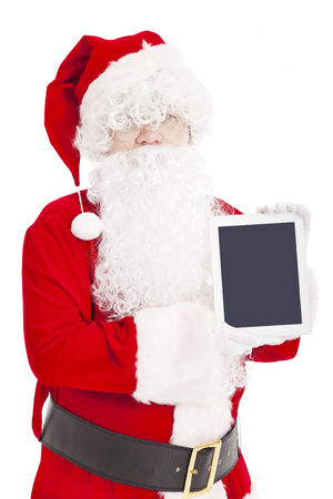 santa claus showing tablet pc  photo