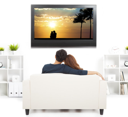 man couch: young couple on sofa watching TV