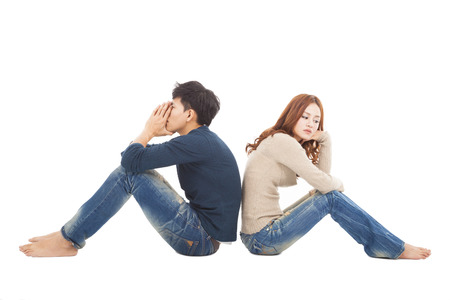 young Couple sitting back to back  during  conflict photo