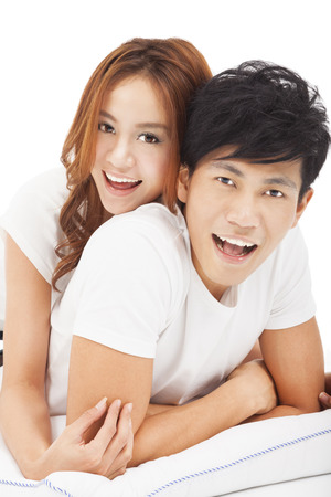 young Man carrying girlfriend in bed photo