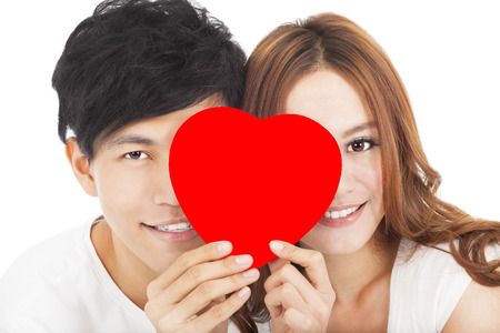 dating and romance: smiling couple holding the love sign