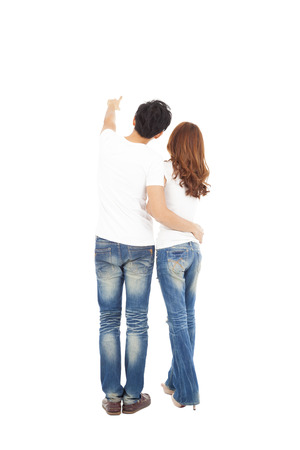 bum: rear view of young couple looking and pointing