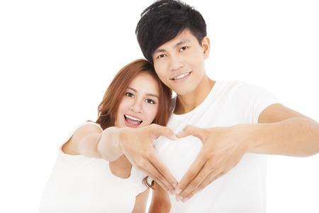 happy couple white background: Young couple  making heart shape by hands