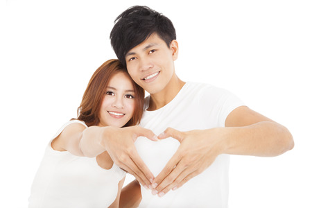 Young couple  making heart shape by hands photo
