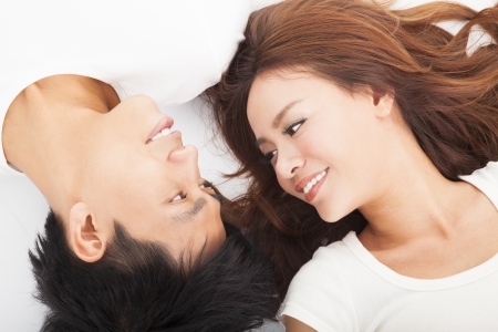 smiling Young couple  lying together photo