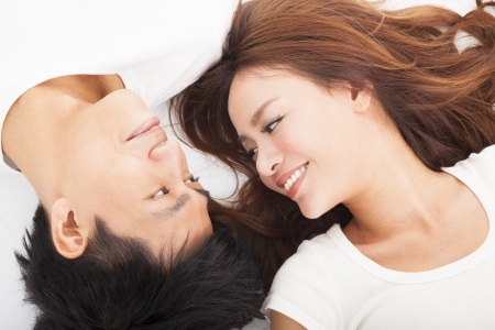 Young happy  couple  lying together photo