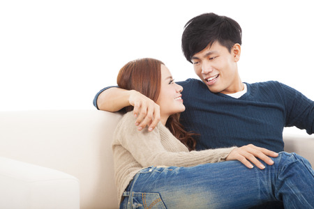 Young couple on the sofa in love Stock Photo - 24232075