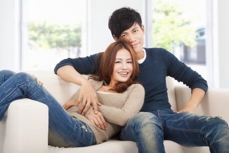 living together: happy Couple in sofa  at home