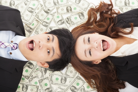 surprised businessman and woman lying on the money photo