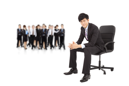 young businessman with successful business team photo