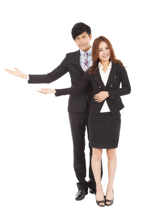 gesture: Young smiling business woman and man with welcome gesture