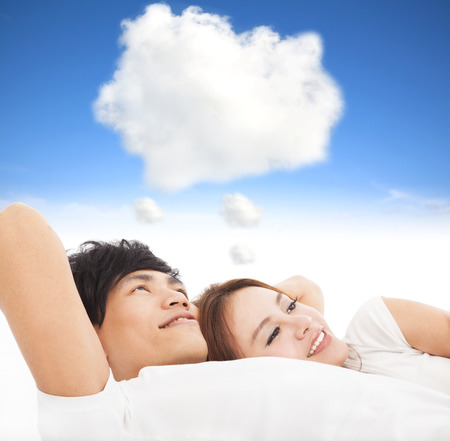 couple sleeping on the bed with dream cloud concept Stock Photo - 24397192