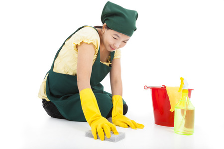 smiling Service woman cleaning the floor  photo