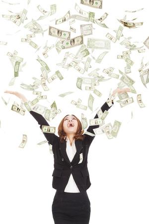 dinero: feliz empresaria tratar de atrapar el dinero Foto de archivo