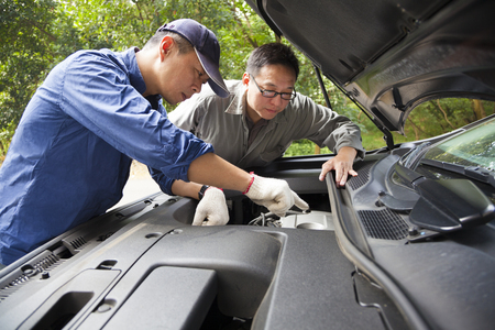 Auto mechanic fixes a car in service photo