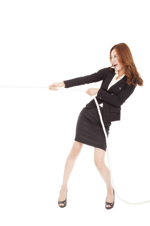 woman rope: businesswoman playing tug of  war