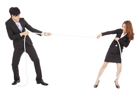 office force: businessman and woman playing tug of  war