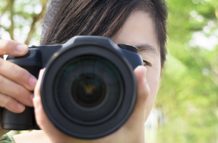 snap: close up of young woman holding camera