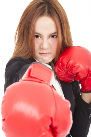 angry Businesswoman boxing punching towards and ready to fight photo
