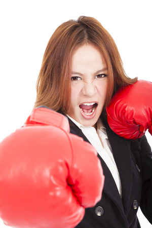 Businesswoman boxing punching towards and ready to fight photo