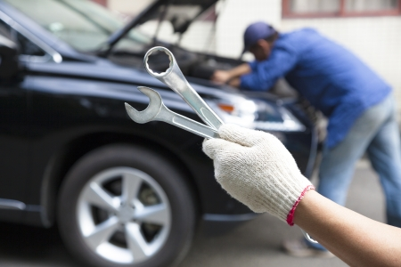 hand holding tools and car service concept photo