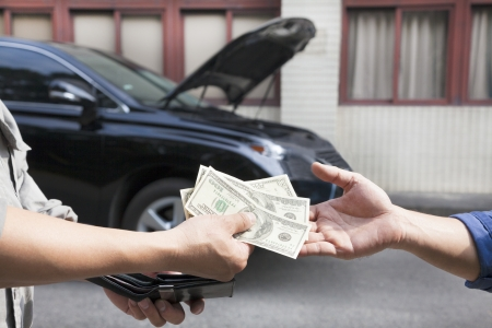 us money: giving and taking money for car service concept