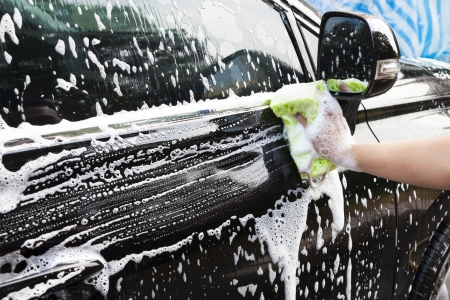foam hand: hands hold sponge  for washing car Stock Photo