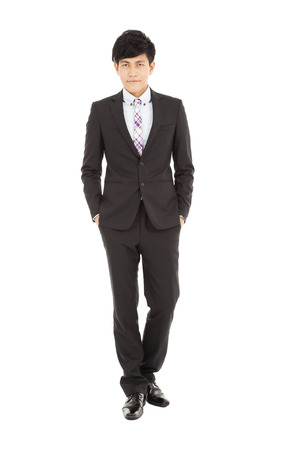 Full length of  young businessman standing Stock Photo - 24521137