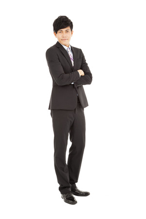 Full length of  young businessman standing Stock Photo - 24521139