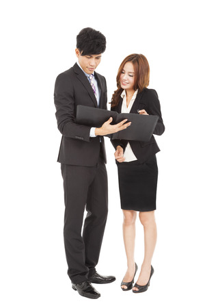 Business people standing and  reading  document together Stock Photo