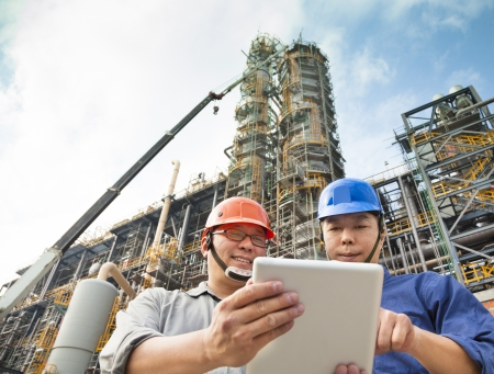 refinery: two Factory workers discussion with tablet pc Stock Photo