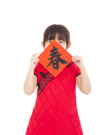 happy little girl showing red couplets for chinese new year.chinese mean spring time photo