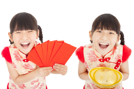 chinese dress: happy  chinese new year. little girl showing red envelope and gold for lucky. chinese mean get rich and happy Stock Photo